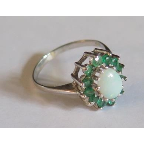 27 - A 9ct White Gold, White Opal and Emerald Ring, size L, 2.1g...