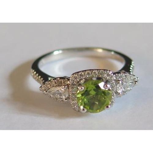 28 - A 14K White Gold, Peridot and Diamond Ring, size M.5, 4g...