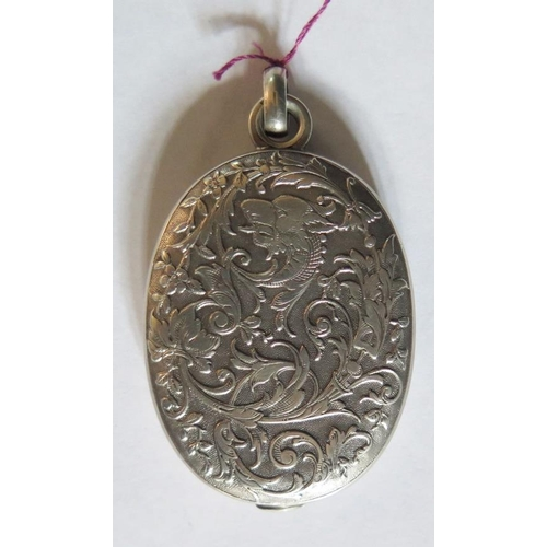 33 - A French Silver Swivel Locket Pendant decorated with griffin and lions head with a stylised foliate ...