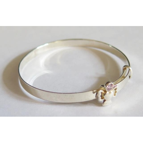 43 - A Sterling Silver Christening Bangle...