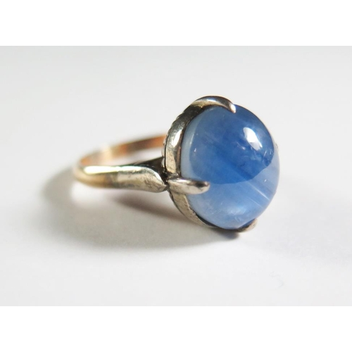39A - An 18K Blue Star Sapphire Ring retailed by Star Jewellery, 13x11mm...