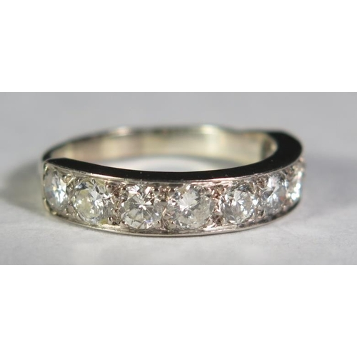 4 - A Nine Stone Diamond Half Eternity Ring in a precious white metal setting (EDW 1.5ct), size T.5, 5.6...