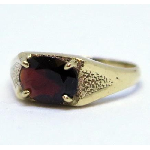 12 - A 9ct Gold and Garnet Dress Ring, size R, 3.4g...