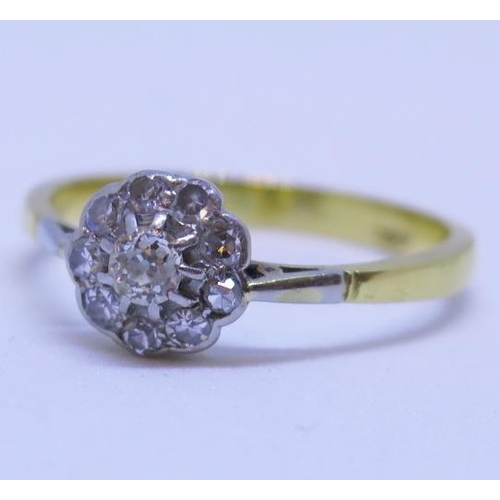 14 - An 18ct Gold and Diamond Cluster Ring, size R.5, 3.8g...