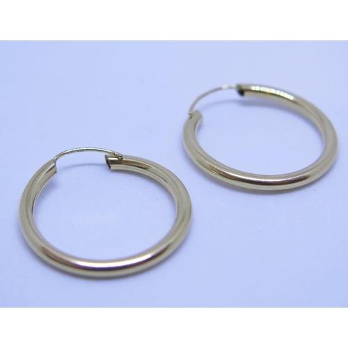 22 - A Pair of 9ct Gold Hoop Earrings, .9g...