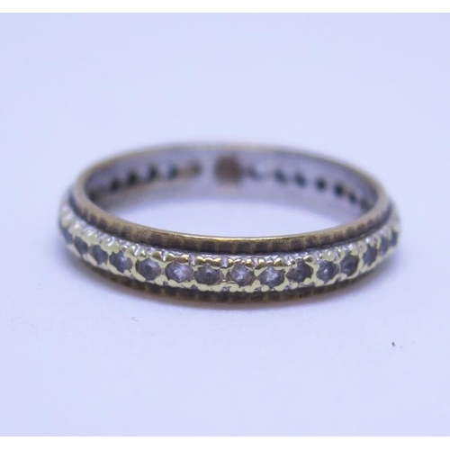 23 - A 9ct Gold and Diamond Eternity Ring, size Q, 2.9g...