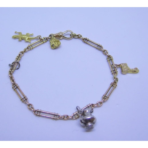 28 - A 15ct Gold Bracelet with charms and gold nugget, 12.6g gross...