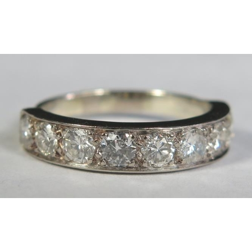 3 - A Seven Stone Diamond Half Eternity Ring in a precious white metal setting (EDW 1.2ct), size L.5, 4....