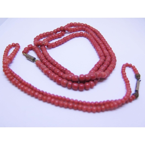 32 - An Antique Coral Bead Necklace, c. 82cm long, 49g and one other 12.3g...