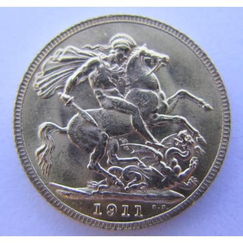 36 - A 1911 Gold Sovereign, VF...