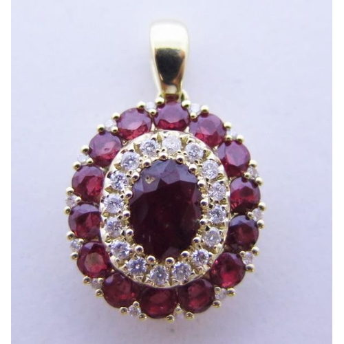 43 - A 14ct Gold, Ruby and Diamond Pendant, central ruby .62ct...