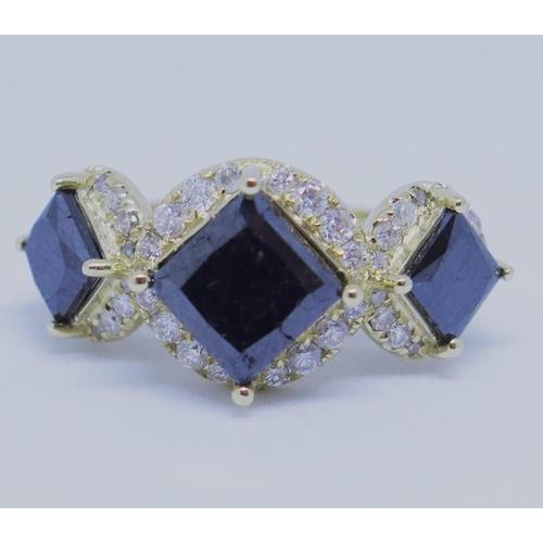 44 - A 14ct Gold Black Diamond Trilogy Ring, 5.05ct TDW...