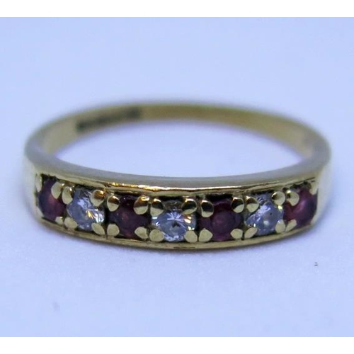 7 - A 9ct Gold, Ruby and Diamond Seven Stone Ring, size L, 1.8g...