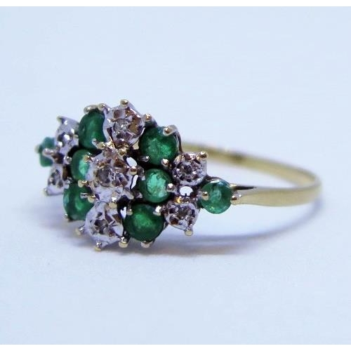 9 - A 9ct Gold, Emerald and Diamond Cluster Ring, size R, 1.8g...