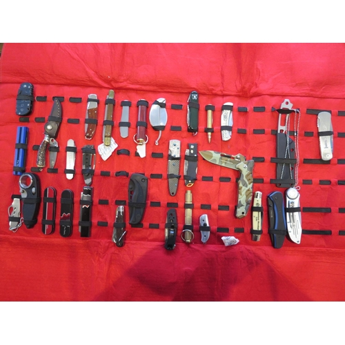 1 - A Selection of Collector's Knives in a wrap case including: Stanley, Sandvik, CRKT, Gerber, Tops and...