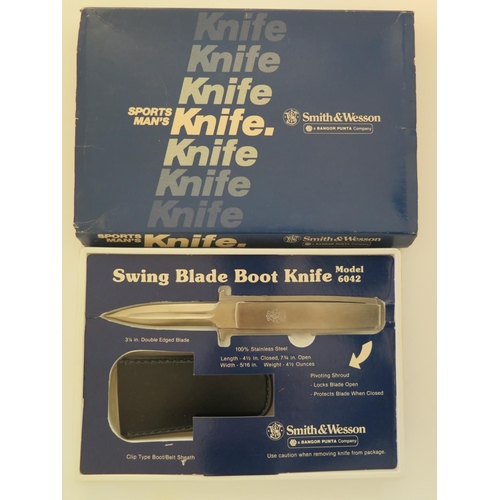 7 - A Smith & Wesson Sports Man's 6042 Swing Blade Boot Knife...