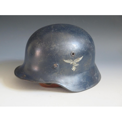 394 - A WWII German Luftwaffe DD helmet with early Eagle transfer, rim stamped Q62 & T605, with chin strap...