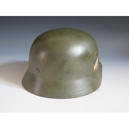 395 - A German WWII Army DD Helmet, rim stamped Q66 & DN311, leather stamped 58, no chin strap **WITHDRAWN...