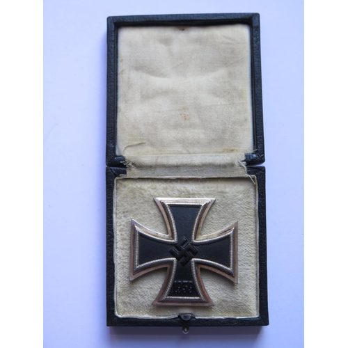 406 - A WWII German 3rd Reich Iron Cross 1st Class (vaulted), pin stamped 65, boxed...