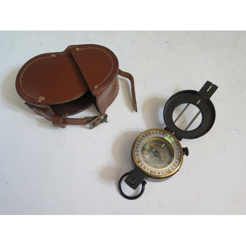 418 - A Post WWII Marching Compass in leather pouch, no markings...