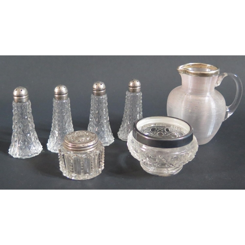 28 - A Victorian Glass and Silver Mounted Jug (London 1892), silver mounted cruets etc....