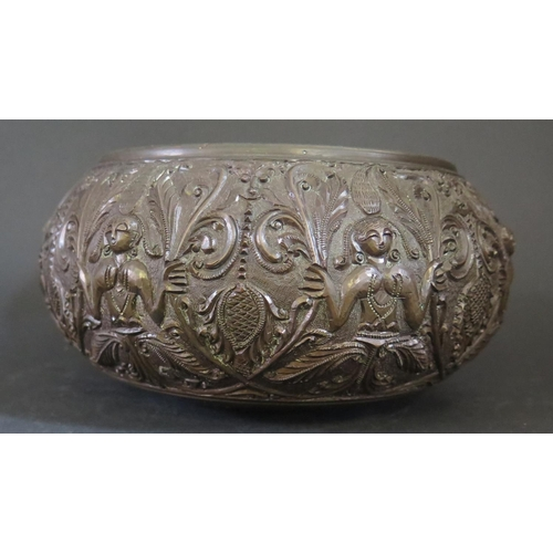 529 - An Asian Bronze Bowl decorated with figures holding fronds, 20cm diam....