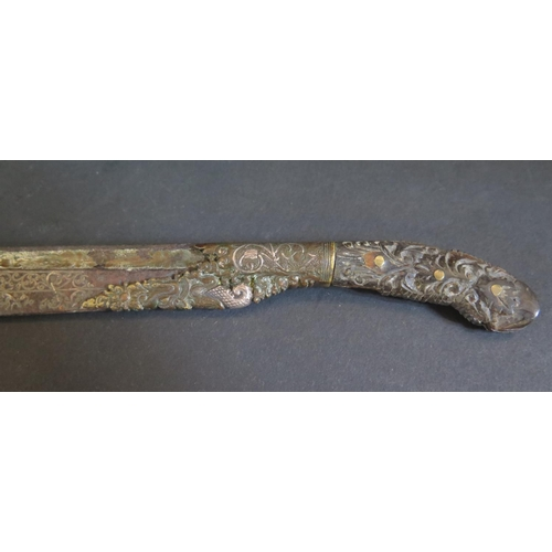 1189 - An 18th Century Middle Eastern Knife, the steel blade with silver inlay and carved wooden handle, 24...