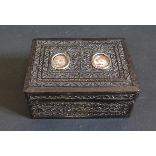 1190 - A 19th Century Indian Carved Ebony Box mounted  with miniatures of Shah Jehan and his son, 9.5cm...