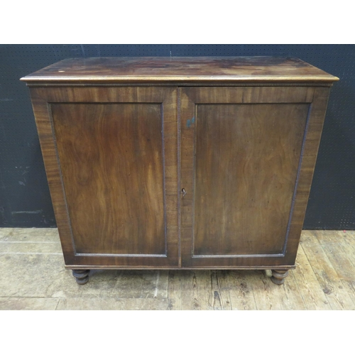 1470 - A Regency Mahogany Press Cupboard fitted with three slides and two drawers over, 111(w)x53(d)x101(h)...