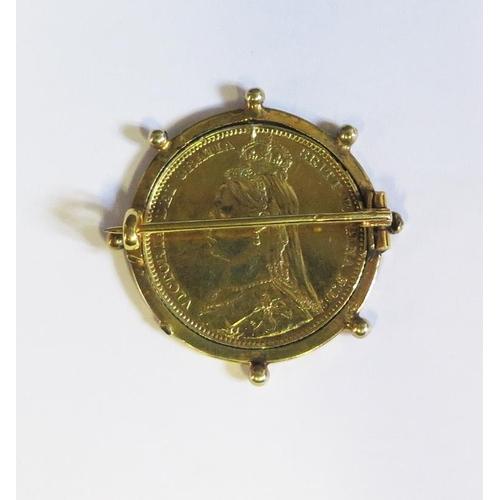 29 - A Victorian Silver Gilt Shilling Revolving Coin Brooch