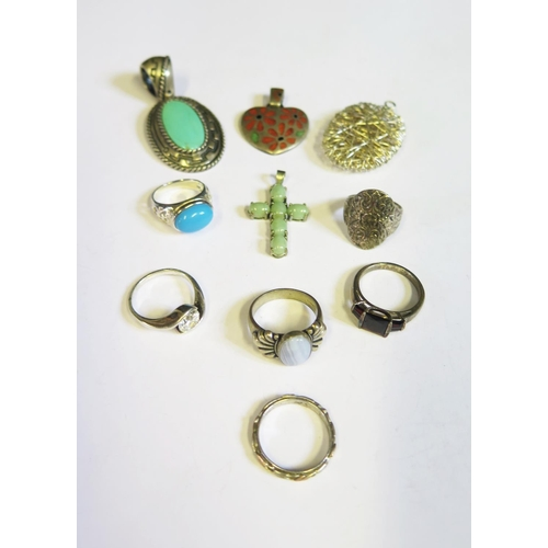 54 - A Selection of Silver Rings and Pendants