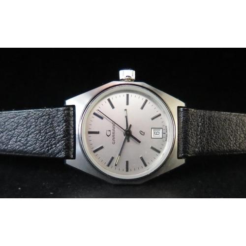 383 - A Cased Ladies GARRARD Q Steel Cased Quartz Wristwatch, appears unworn. Needs new battery...