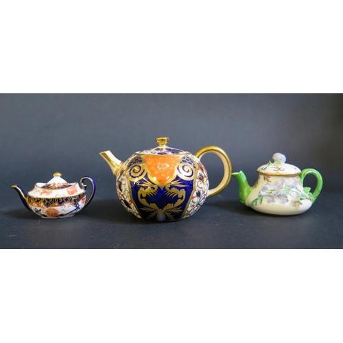 1226 - A Davenport Miniature Imari Palette Teapot (7cm high), Royal Crown Derby miniature teapot and one ot...
