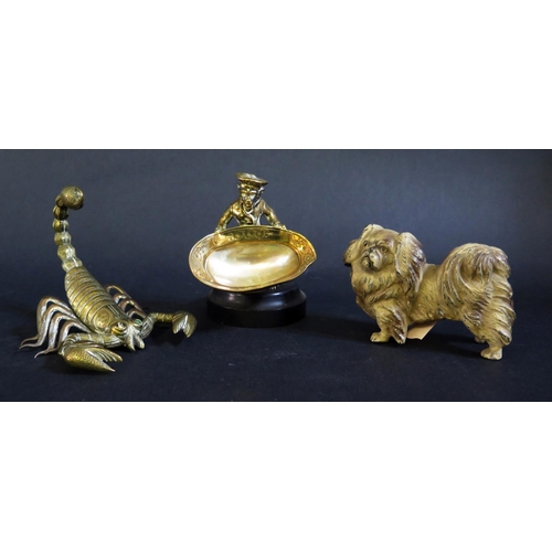 1249 - A 19th Century Brass and Mother of Pearl Novelty Salt in the form of a monkey holding basket (9cm), ...
