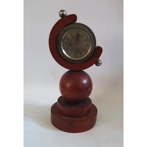 1258 - A Stadium 8 Day Bezel Wound Clock in bespoke case, 31cm tall. A/F