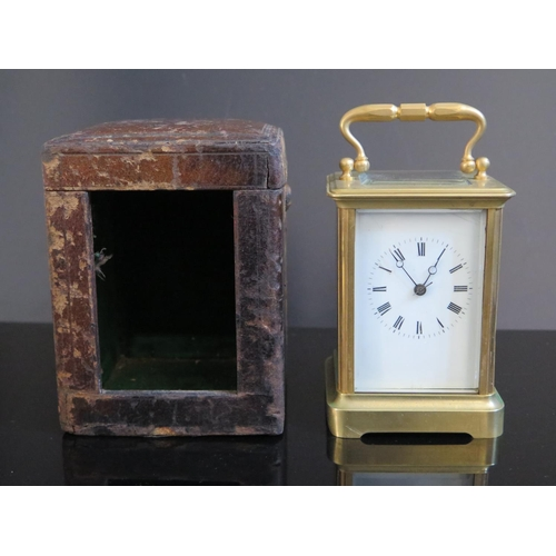 1261A - A 19th Century Cased Brass Striking Carriage Clock, 15.5cm, running. Glass at back cracked