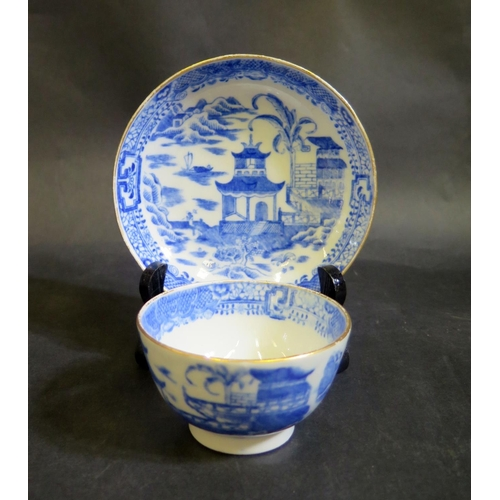 1307 - A Blue and White Porcelain Tea Bowl with matching saucer