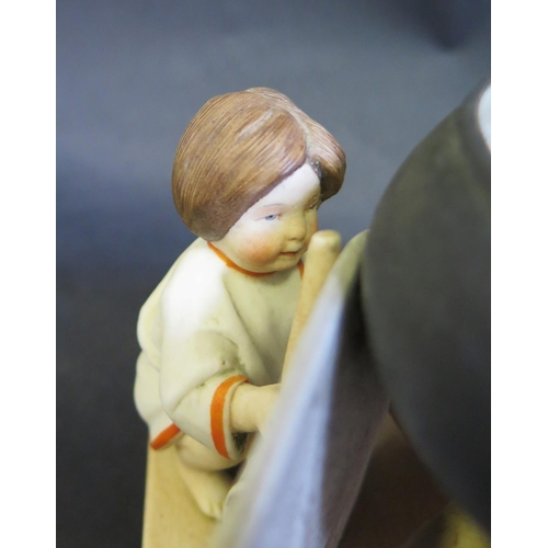 1311 - A Russian Biscuit  Figure of a Hiding Girl Holding a Rolling Pin by the Gardner Factory, c. 1890, ma...