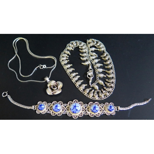 29 - A Silver Rose Pendant Necklace, silver and Delft panel bracelet (26g) and white metal necklace...