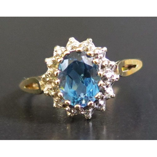 35 - A 9ct Yellow Gold, Blue Topaz and Diamond Ring, size O.5, 2.2g...