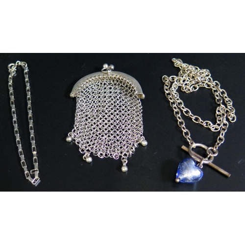 18 - A Silver necklace with glass heart pendant, small silver bracelet (15g) and white metal mesh purse...