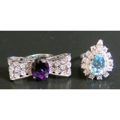 25 - A Silver and Amethyst Dress Ring and one other, 14g...