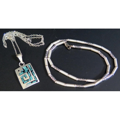 27 - A Silver Pendant Necklace (12g) and white metal necklace...