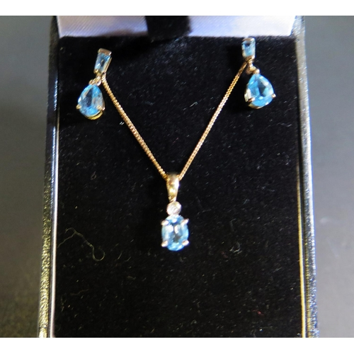 36 - A 9ct Gold, Aqua Marine and Diamond Pendant Necklace with 16mm drop (clasp needs replacing) with pai...