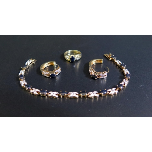 37 - A Gold Plated Sapphire and White Stone Costume Bracelet with matching ring and earrings...