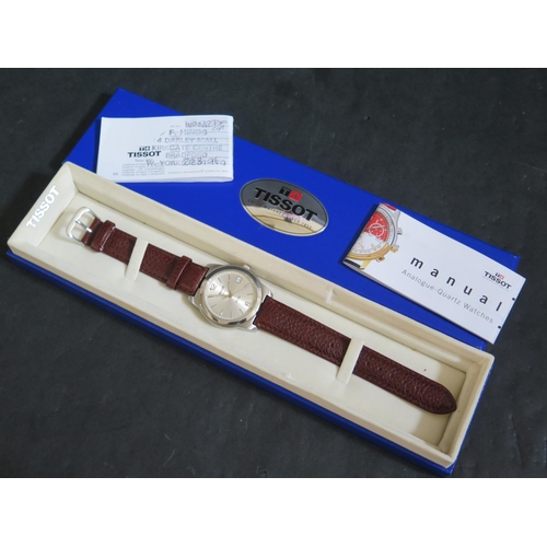 394 - A TISSOT Gent's Wristwatch, boxed and with papers, running