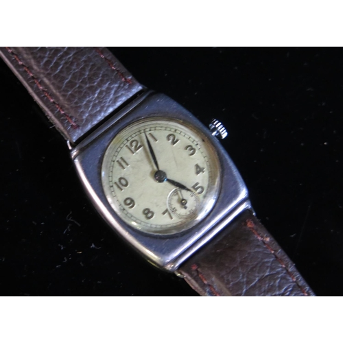 406 - A Silver Cased Writwatch with UNO 15 jewel movement, London 1941 (needs attention)