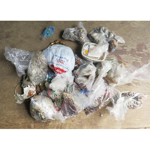 42 - A Bag of Costume Jewellery and beads etc. for making jewellery...