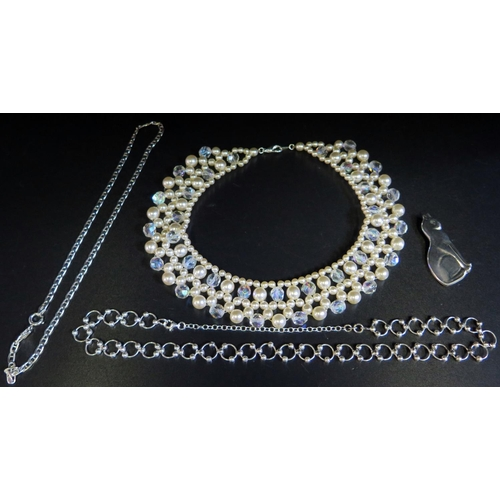 7 - A Silver Cat Brooch, two silver necklaces (30g) and simulated pearl necklace...