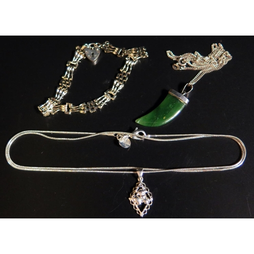 8 - A Silver and Nephrite 'Tiger's Claw' Pendant Necklace, silver gate link bracelet and silver Taurus p...